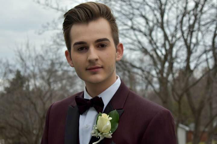 High school boy wearing a tuxedo