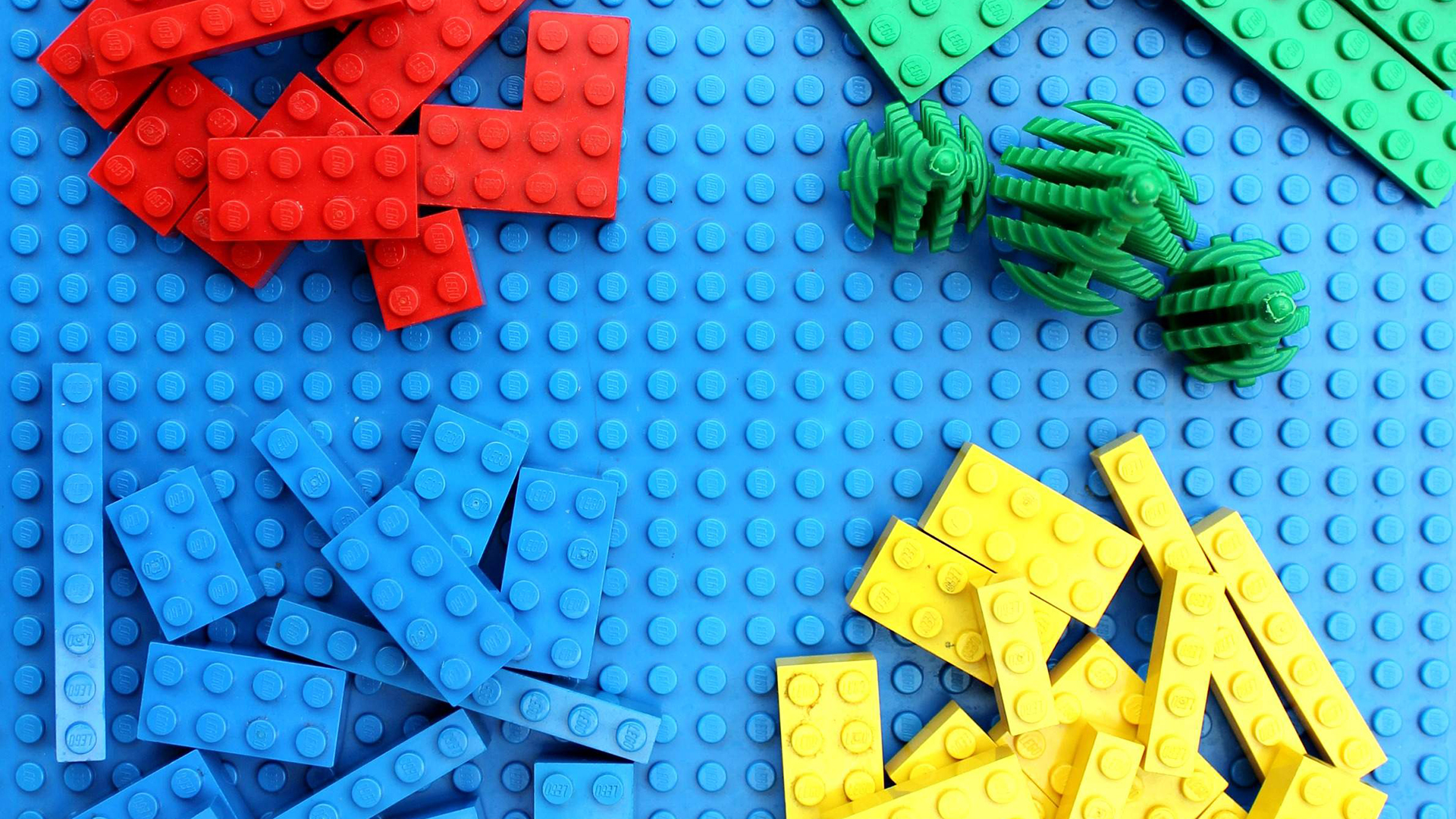 lego blocks stacked in piles by color