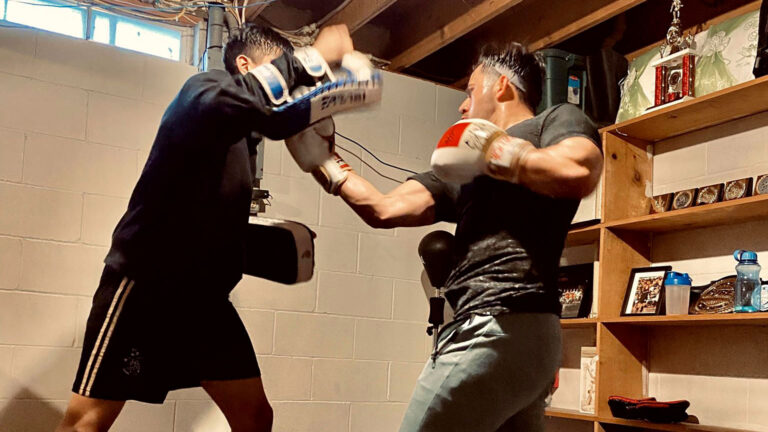 Two fighters training in a basement