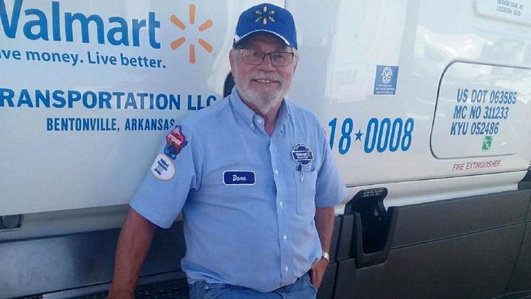 Truck driver standing next to Walmart truck