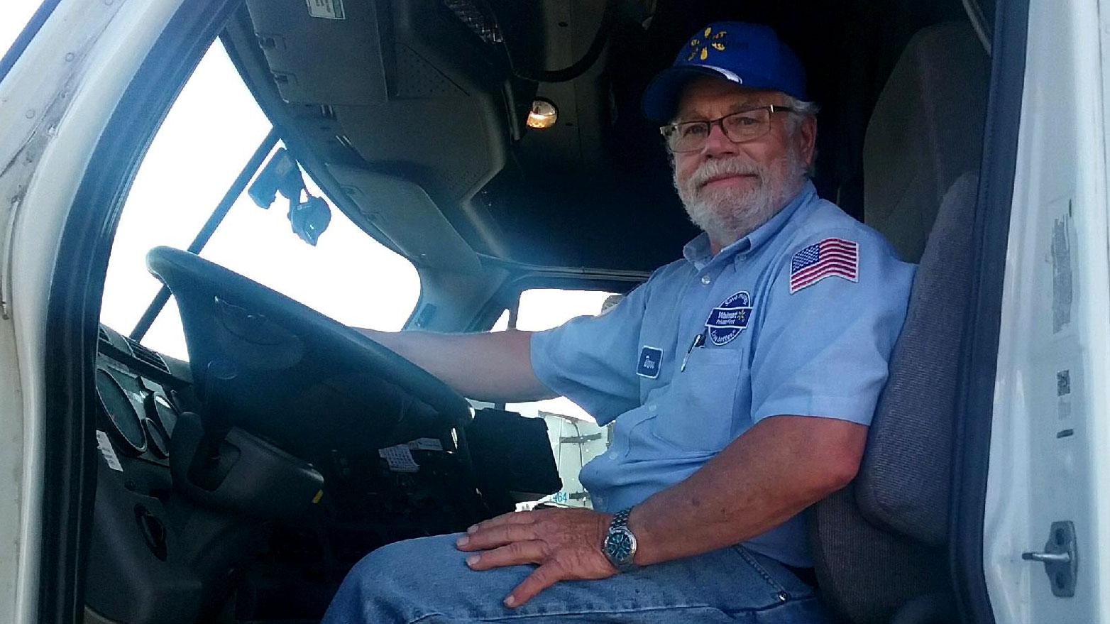 Truck driver sitting behind the wheel