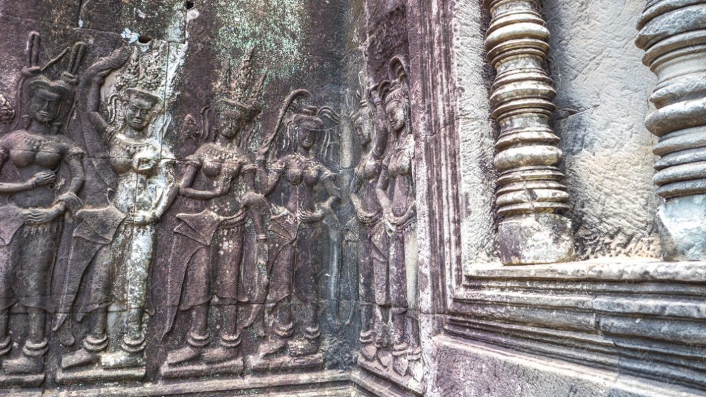 Sandstone carving of dancing Apsara on the wall of Angkor Wat, Cambodia