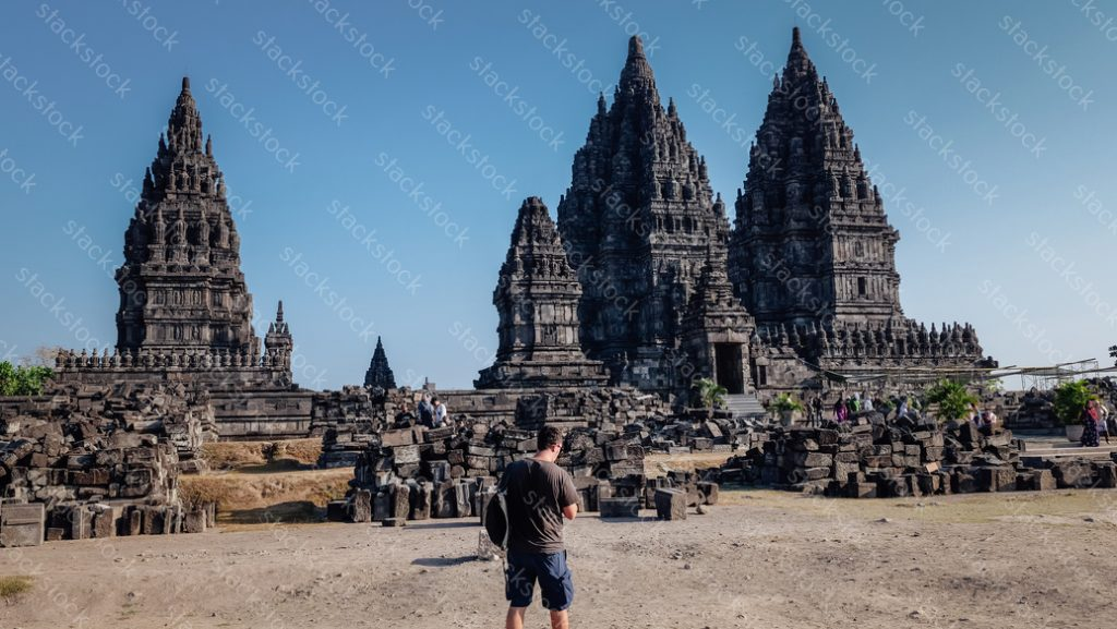 Male tourist at Prambanan Temple. Indonesia