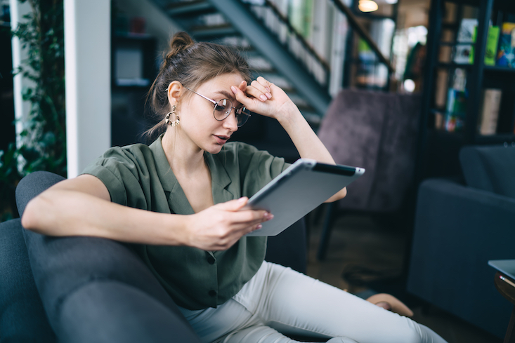 Girl on tablet: getting TEFL certified: is TEFL worth it?