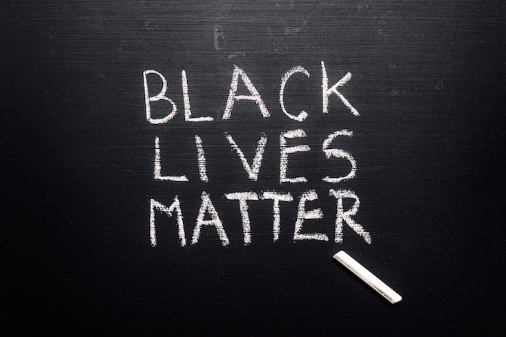 "Anti-racism resources in the classroom. Photo of chalkboard with text ""Black lives matter"""