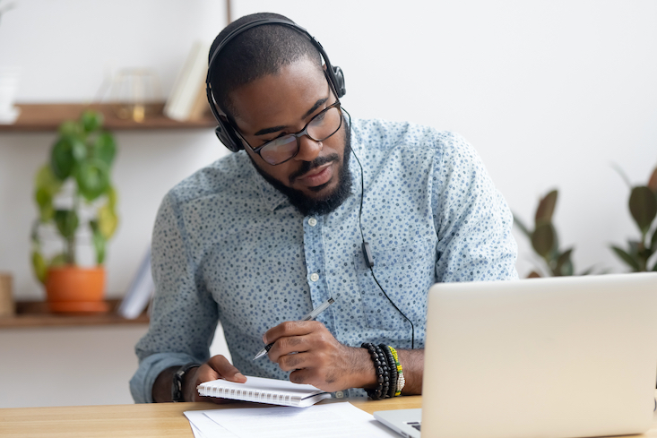 Man on computer researching Teaching license reciprocity.