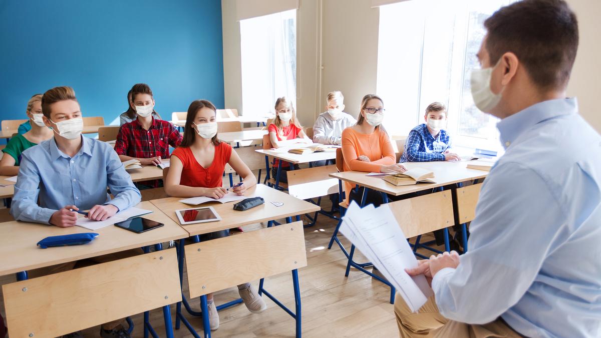 man teaching a class of high school students
