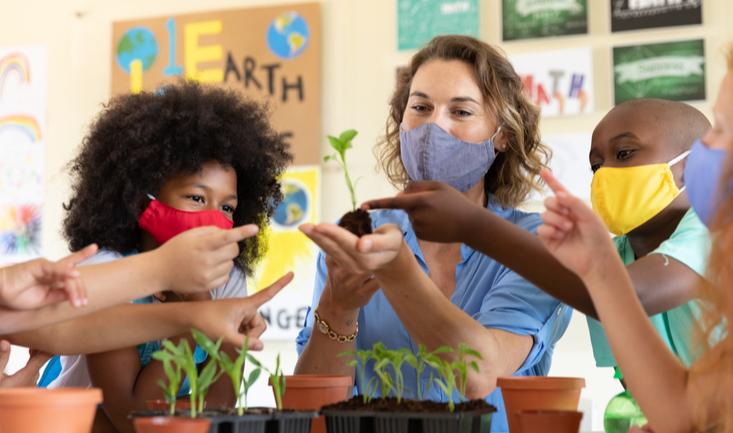 teacher gardening with students