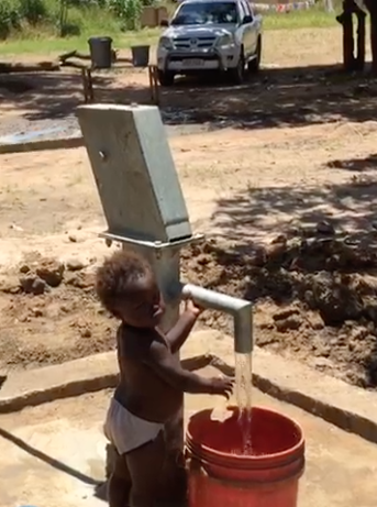 This baby is enjoying the benifit of clean water from an early age!